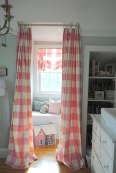 Nursery with pink buffalo check curtains