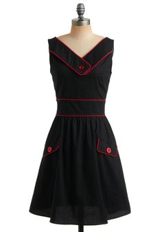 Rockabilly, somewhere between baby doll and sailor's sweetie with snappy buttons and piping.