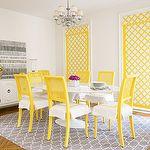 dining rooms - gray Moorish tiles rug bright yellow painted lattice chairs white Hollywood Regency cabinet buffet white yellow lattice roman shades