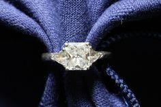 Modified radiant cut diamond with 2 diamond trillions set in platinum. Radiant Engagement Rings, Wedding Engagement, Radiant Cut Diamond, Diamond Cuts, Brooch, Pretty, Wedding Stuff, Jewelry, Fashion