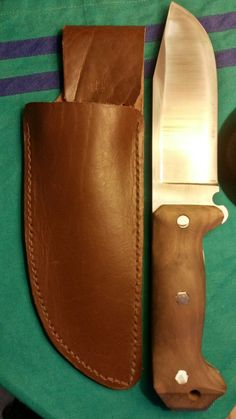 Final product with a walnut handle and leather holster.
