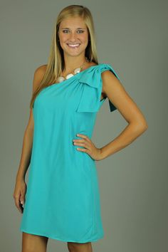 BEST OF BOWS DRESS, TURQUOISE...Easy breezy! The boxy silhouette of this dress is just too darn cute! We are obsessed with the big bow on the shoulder...doesn't get much more girly than that:) This dress is great for any shape or size...it will not cling to your body! Put a belt with this dress to achieve a more fitted look.