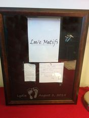 The LoveMotifs Shadowbox keepsake.  Perfect for keeping all those treasured items from when your baby was first born.  Imprint Kit included.