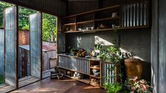 Nishizawa Architects has replaced the facade and interior walls of this residence in Vietnam's An Giang province with moveable corrugated metal panels.