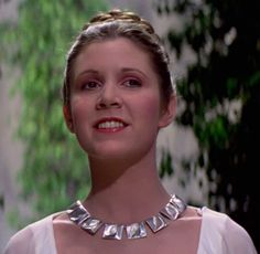 Closeup of Leia Yavin medal ceremony. The stunning silver necklace and bracelet worn with this gown were purchased from a London jeweler.
