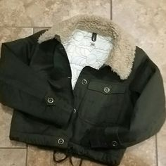 Fossil Jacket Gorgeous size XS Fossil brand jacket. Army green with ivory quoted lining.  Excellent condition.  I wear a size small and fits perfect. Fossil Bags