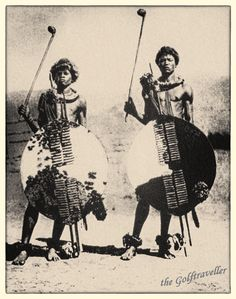 obviously there is some history of golf in South Africa photo from a picture Swaziland -  Those are carved out wooden sticks used by  most Africans either as weapons or a cane. Sometimes called  knobkerrie in South Africa.