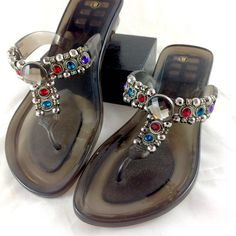 Palm Harbor Jeweled Jelly Sandals Brand new with tags! NWT. Smokey gray colored jelly sandals with beautiful colored stones and silver beads. Size 8. 🔹Please ask all your questions before you purchase! I am happy to help! 🔹Sorry, no trades. 🔹Please, no lowball offers. 🔹Happy Poshing! Palm Harbour Shoes Sandals
