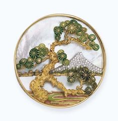 AN AMUSING 'MOUNT FUJI' LANDSCAPE BROOCH, BY BULGARI   Of circular form depicting a scene of 'Mount Fuji' in pavé-set diamonds with mother of pearl sky and lake to the gold and green enamel pine tree in the foreground, 6.4 cm diameter, with French assay mark for gold  Signed Bulgari