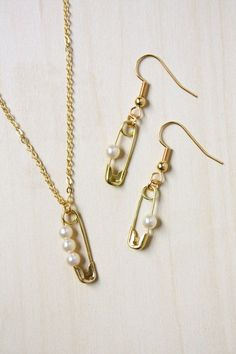 Safety Pin and Pearl DIY Jewelry Tutorial -- make an earring and necklace set! - jewelry rings engagement, online diamond jewellery store, modern jewelry *sponsored https://www.pinterest.com/jewelry_yes/ https://www.pinterest.com/explore/jewellery/ https://www.pinterest.com/jewelry_yes/wholesale-jewelry/ https://www.jared.com/