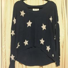 Billabong Women's Sweater with Stars size small Billabong women's crew neck sweater with stars. Navy with white stars size small. Loose fitting. 100 percent cotton. No snags in the fabric. Super cute for 4th of July!  Billabong Sweaters Crew & Scoop Necks