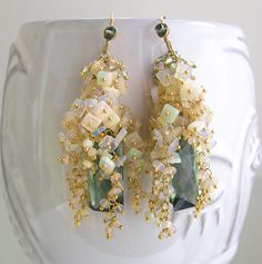 ........shimmering.....glittering.....elegance.....  Tumbling cascades of opal chiclets sit on vermeil head pins, beneath small clusters of green
