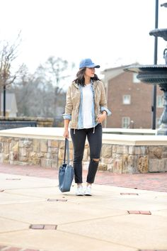 How To Wear A Baseball Hat Like A Fashion Blogger - My Style Vita. White top+chambray shirt+black ripped jeans+white sneakers+beige utility jacket+blue bucket bag+blue cap. Spring Casual Outfit 2017
