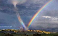 Stunning rainbow meets tornado