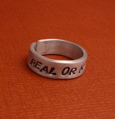 Simple and adorable  Hunger Games Inspired  Real Or Not Real Hand by chasingatstarlight, $10.95