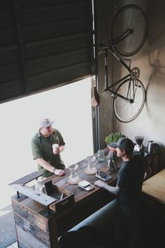 Coffee shop; roll up door, wood counter and hanging bike