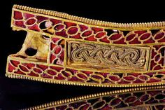 Realms Of Gold The Novel: The Staffordshire Hoard              The Staffordshire Hoard This mysterious piece, almost four inches long, uses the same principle as the brake lights of modern cars: The wafflelike texture of the gold under each garnet increases the gem's reflectivity. -