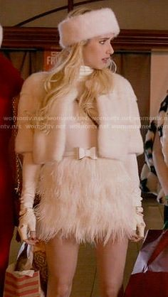 Chanel�s white cropped fur jacket and feather skirt on Scream Queens. Outfit Details: http://wornontv.net/54517/ #ScreamQueens
