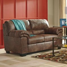 An Ashley Furniture coffee brown loveseat is cozy and chic. Bladen Loveseat | Weekends Only Furniture and Mattress