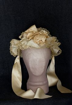 Fancy silk bonnet, 1850s  With elaborate trim and soft ruffled brim, the lovely bonnet embodies the Romantic period aesthetic.
