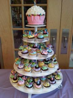 Sweet 16 Birthday party tower of cupcakes topped with a giant cupcake!