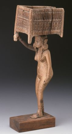 The unusual hairstyle of this figure suggests that she may represent a foreigner. The hole pierced through this girl's hanging hand9 was probably intended to hold the handle of an applicator.