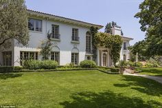 Sprawling: The 7,500 square foot luxury mansion is nestled in the hills with roving views of LA, and boasts the likes of Casey Affleck, Natalie Portman, Lauren Graham, Will.I.Am and David Fincher as neighbours