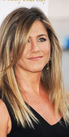 "Jennifer Aniston has been a hair icon since her days as Rachel Green on Friends back in the Her sleek, layered style—dubbed ""The Rachel""—sent women flocking to salons with Jen's portrait in hand. Now that she's earned full-on hair muse status,… Brad Pitt Jennifer Aniston, Peinados Jennifer Aniston, Jennifer Aniston Quotes, Jennifer Aniston Hair Color, Jennifer Aniston Pictures, 40 Year Old Hair Styles, Long Hair Styles, Jennifer Anston, Classic Haircut"
