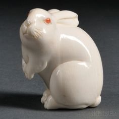Ivory Netsuke of a Rabbit, Japan, 19th century, sitting with forearms raised and…
