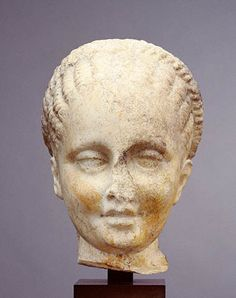 Head of a Girl (Getty Museum). This little girl wears her hair pulled back in a lobed, braided hairstyle called a melon coiffure by scholars.