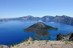 Wizard Island in Crater Lake, Oregon, USA.  Photo by John Kelly  http://twitter.com/jakphoto http://facebook.com/jakphotoart http://www.pinterest.com/jakphoto http://uk.linkedin.com/in/jakphoto http://www.jakphoto.co.uk