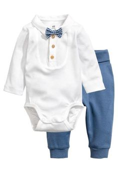 Set with a bodysuit and trousers in soft organic cotton jersey. Long-sleeved bodysuit with a collar and woven shirt front. Sewn-on bow tie, a button placket Baby Outfits Newborn, Toddler Outfits, Baby Boy Outfits, Kids Outfits, Baby Boy Fashion, Fashion Kids, Romper Suit, Baby Set, Cute Baby Clothes