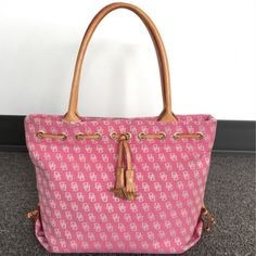 """Dooney&Bourke handbag authentic color Pink Dooney&Bourke handbag authentic  color Pink  size Medium lenght 13"""" height 10""""  Depth 5""""1/4very  Strap Drop 9"""" Max just only one corner is a little bit damaged. But handbag is in good condition. Inside is very clean looks like new ! Dooney & Bourke Bags"""