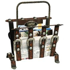 http://www.lonestarwesterndecor.com/metal-belt-magazine-rack.html
