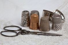 Collection of old thimbles and scissors  --    STITCHBOOK.NET