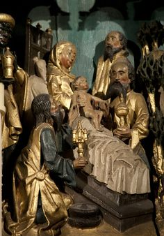 A rather charming detail from the fragments of medieval carving incorporated by Pugin into the reredos at Oscott College chapel. This shows the Magi, not at the stable of Bethlehem, as is normal, but around a rather luxurious bed in which the Blessed Virgin Mary has given birth to the Christ.