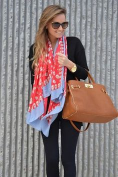 All black with a colorful scarf and tan tote.