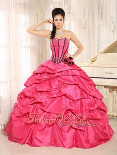 Hot Pink Beaded and Hand Made Flowers Quinceanera Dress With Pick-ups For Custom Made  In Kapaa City   Hawaii  http://www.fashionos.com    Be the belle of the ball in this stunning taffeta ball gown. It features a corset bodice with boning details and shining beading. The black and hot pink flowers bright up the mid-section. The skirt is made from many, many yards of ruched material that create an absolutely beautiful effect in the skirt. The lace up back give you a sense of safty.