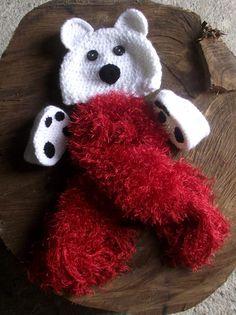 Conjunto confeccionado em crochê. Composição - gorro,cachecol e sapatinho cores - branco com detalhes em preto e vermelho. tamanhos - 0 a 3 / 3 a 6 / 6 a 9 e 9 a 12 meses. frete por conta do comprador. R$ 59,90