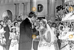 Tricia Nixon Cox samples a piece of wedding cake from her husband Edward at their reception in the East Room of the White House in Washington, D.C. following the wedding ceremony in the Rose Garden on Saturday, June 12, 1971.