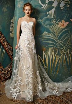 Walking down the aisle will never be more romantic with this full-length A-line gown featuring a low illusion back with crystal buttons, invisible zipper, and strapless sweetheart neckline on an exquisite embroidered lace and tulle bodice. The delicate lace and tulle layer drapes gracefully down to a strikingly modern horsehair hem.