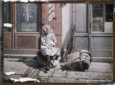 Little girl with doll, France, 1914 | 16 Edwardian Colour Photos That Will Make You Feel Like A Time Traveller