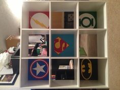 A Wal-Mart bookshelf transformed for a boys room! I painted each of the squares for a super hero! Captain America, Flash Gordon, Superman, Batman and Green Lantern!