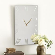 Our Avera Clock turns time into a light-filled statement. The delicately beveled face features etched Roman numerals and slender antique gold hands that mark the time with stylish simplicity.