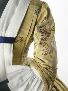 The dress is made of yellow silk taffeta, which is brocaded. This means that the flower design is not embroidered, but woven into the fabric. 18th Century Dress, 18th Century Costume, 18th Century Clothing, 18th Century Fashion, Mid Century, Historical Costume, Historical Clothing, Vintage Outfits, Vintage Fashion