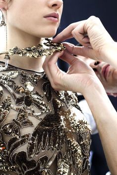 3b70a42a09f An Alexander McQueen Autumn Winter 2018 pre-collection dress is inspired by  the British Art Nouveau style and embroidered with birds and butterflies ...