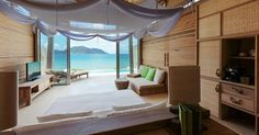 Luxury Hotel in #Vietnam.  Outstanding beach resort patterned after a Vietnamese fishing village, with 50 villas overlooking a glorious white-sand beach framed by green mountains, dense forests and glades of bamboo. Villas offer butler service, private infinity pools, large picture windows, terraces with daybeds, and roomy baths with terrazzo soaking tubs and outdoor showers. #hideawayoftheday