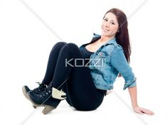 girl sitting with knees up - Young woman sitting and smiling with her knees up. Model: Sierra Walsh