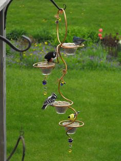 Bird Feeder - copper plumbing tubing, dollar store bowls, colorful baubles and copper wire.
