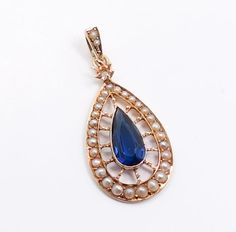 This is a stunning Victorian era necklace pendant for restoration. The pendant is finely crafted in 14k gold with a graceful teardrop shape. The pendant features a large vividly hued sapphire surrounded by dainty seed pearls. | eBay!